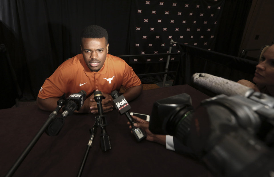 Photo - Texas running back Malcolm Brown speaks to reporters during the NCAA college Big 12 Conference football media days in Dallas, Tuesday, July 22, 2014. (AP Photo)