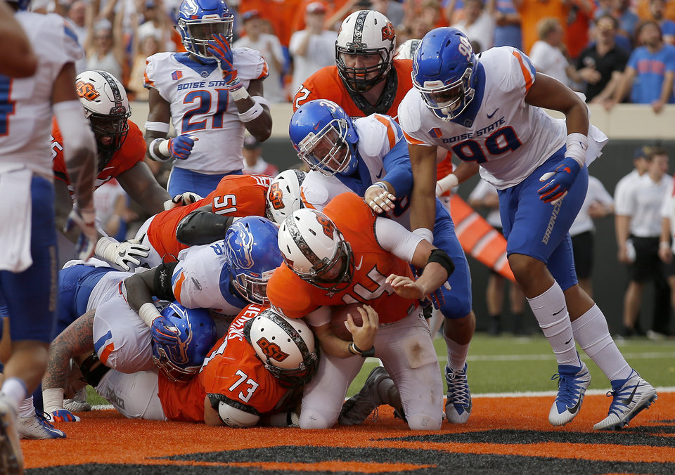 Photo - during a college football game between the Oklahoma State Cowboys (OSU) and the Boise State Broncos at Boone Pickens Stadium in Stillwater, Okla., Saturday, Sept. 15, 2018. OSU won 44-21. Photo by Sarah Phipps, The Oklahoman