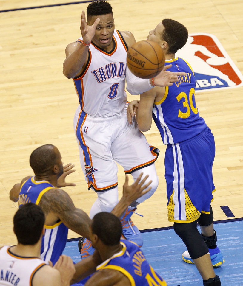 Photo - Oklahoma City's Russell Westbrook (0) passes the ball from beside Golden State's Stephen Curry (30) as Andre Iguodala (9) during Game 6 of the Western Conference finals in the NBA playoffs between the Oklahoma City Thunder and the Golden State Warriors at Chesapeake Energy Arena in Oklahoma City, Saturday, May 28, 2016. Photo by Bryan Terry, The Oklahoman