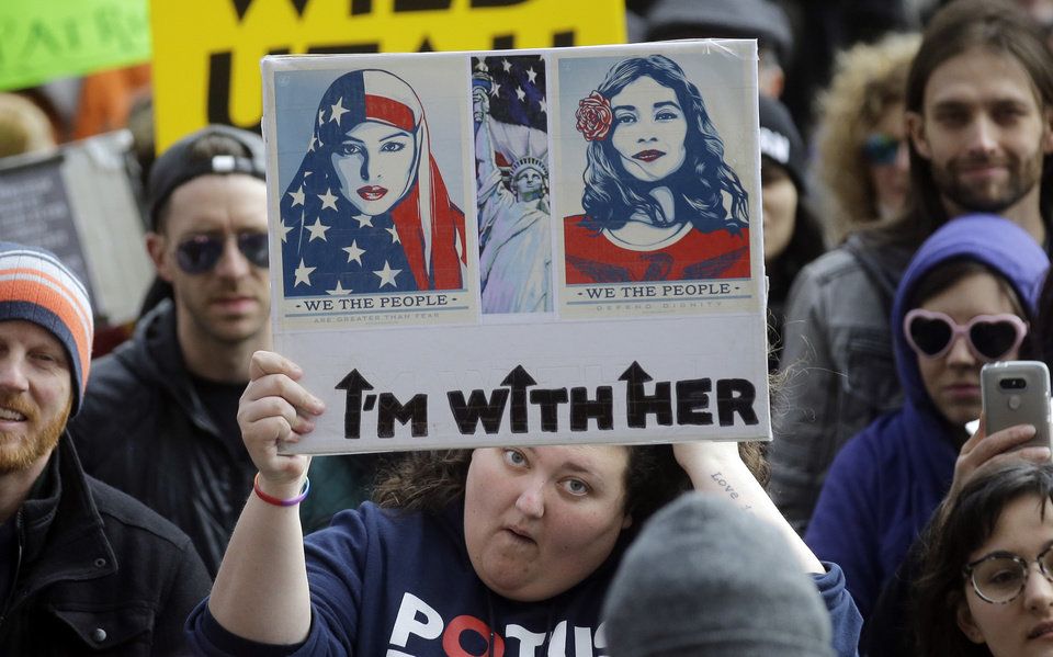 Photo - Demonstrators hold a rally Monday, Feb. 20, 2017, in Salt Lake City. The rally is one of several Not My Presidents Day protests planned across the country to mark the Presidents Day holiday. Protesters are criticizing President Donald Trump's immigration policies, among other things. (AP Photo/Rick Bowmer)