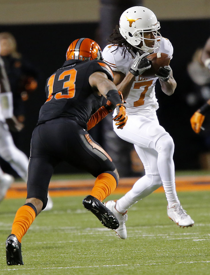 Photo - Texas' Marcus Johnson (7) makes a catch in front of Oklahoma State's Jordan Sterns (13) during the college football game between the Oklahoma State University Cowboys (OSU) the University of Texas Longhorns (UT) at Boone Pickens Staduim in Stillwater, Okla. on Saturday, Nov. 15, 2014.  Photo by Chris Landsberger, The Oklahoman