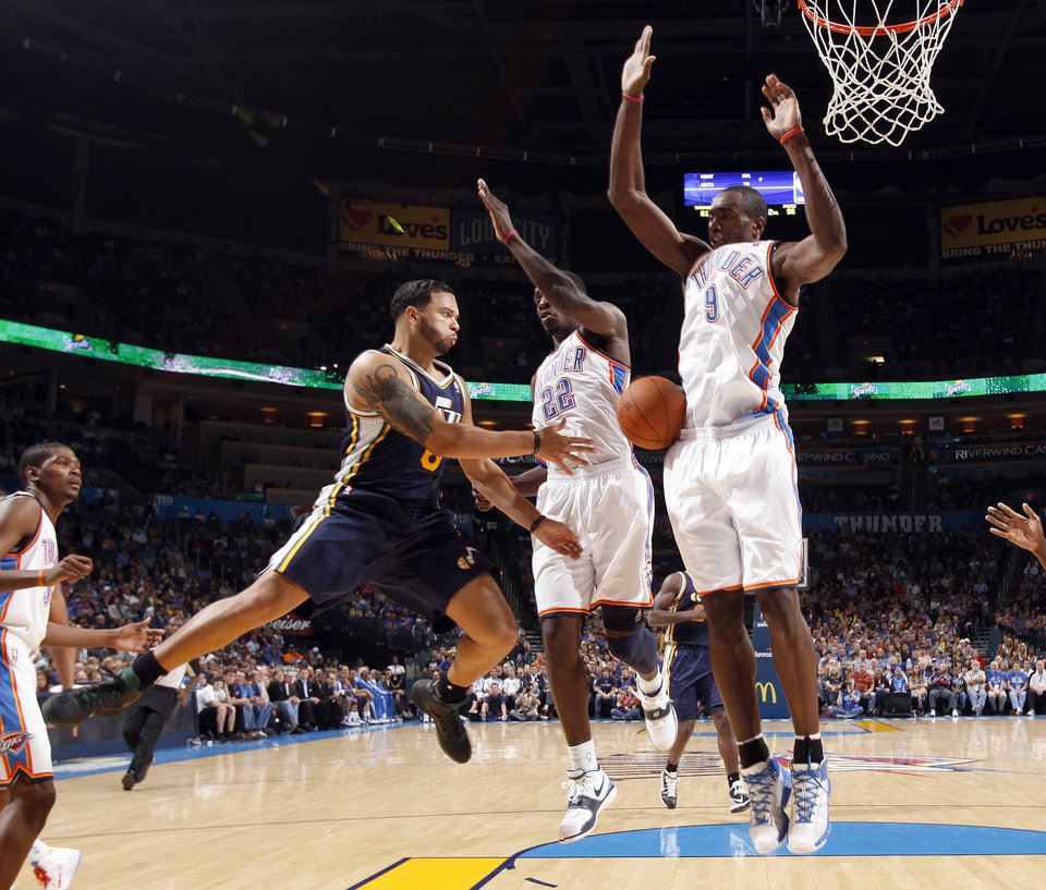 Photo - Oklahoma City's Jeff Green (22) and Serge Ibaka (9) defend against Utah's Deron Williams during the NBA basketball game between the Oklahoma CIty Thunder and Utah Jazz in the Oklahoma City Arena on Sunday, Oct. 31, 2010. Photo by Sarah Phipps, The Oklahoman