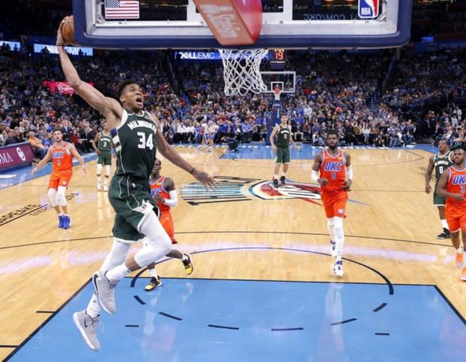 Photo -  Milwaukee's Giannis Antetokounmpo goes up for a dunk during the Bucks' 121-119 win over Oklahoma City on Sunday night at Chesapeake Energy Arena. OKC's record dipped to 4-6.  [Sarah Phipps/The Oklahoman]