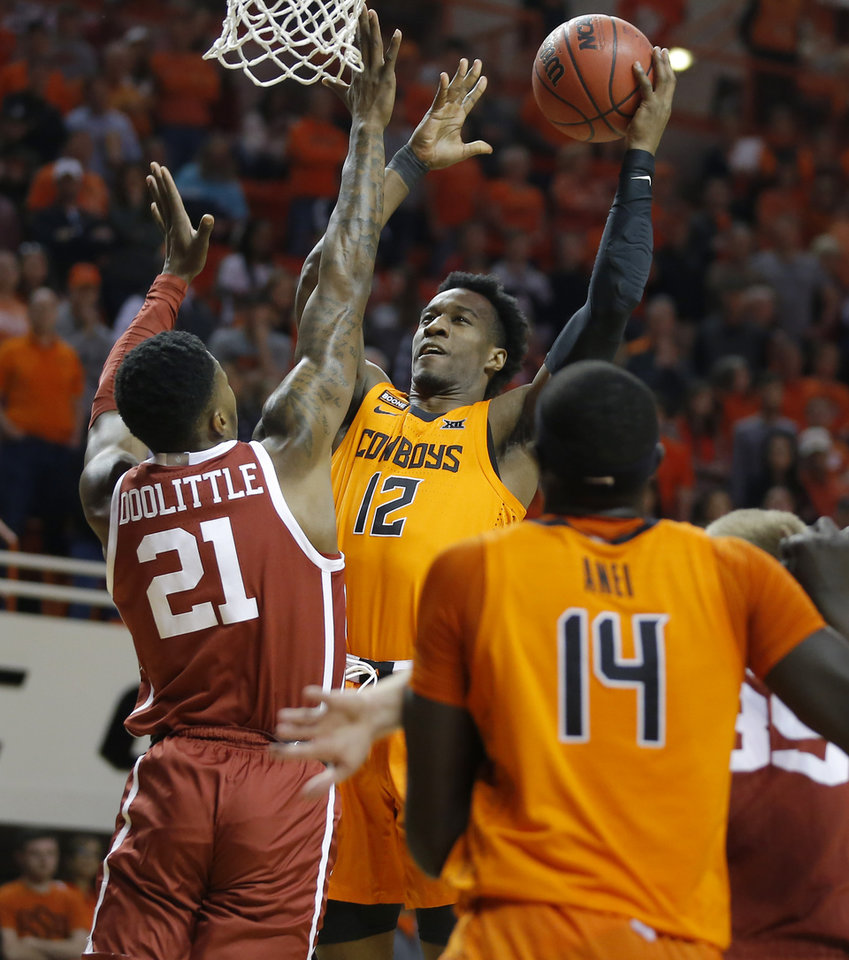 Photo - Oklahoma State's Cameron McGriff (12) attempts a shot beside Oklahoma's Kristian Doolittle (21) during an NCAA men's Bedlam basketball game between the Oklahoma State University Cowboys (OSU) and the University of Oklahoma Sooners (OU) at Gallagher-Iba Arena in Stillwater, Okla., Saturday, Feb. 22, 2020. [Bryan Terry/The Oklahoman]