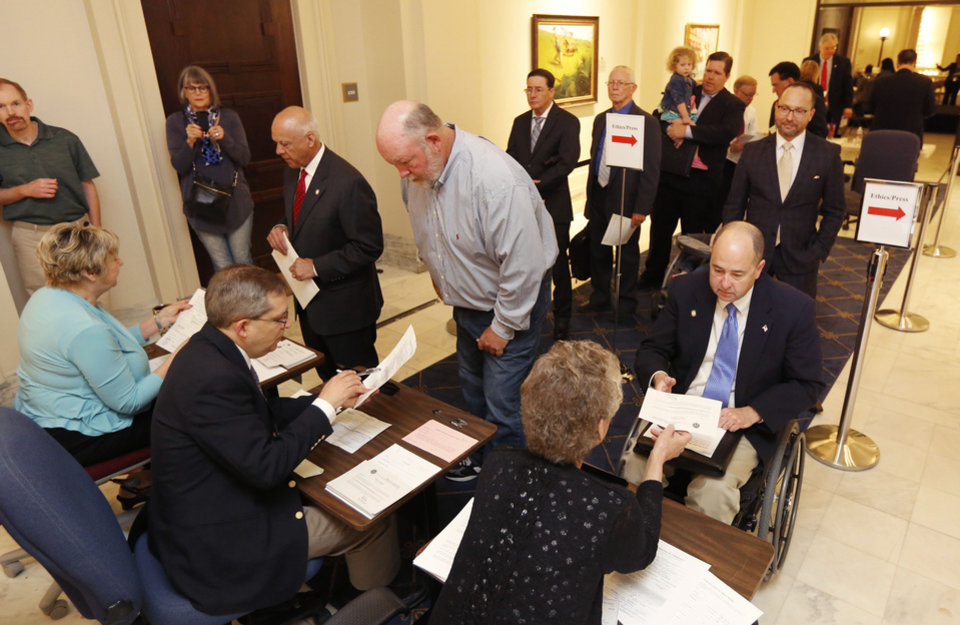 Photo - Candidates line up during the first day of filing for political offices at the State Capitol in Oklahoma City, OK, Wednesday, April 13, 2016,  Photo by Paul Hellstern, The Oklahoman