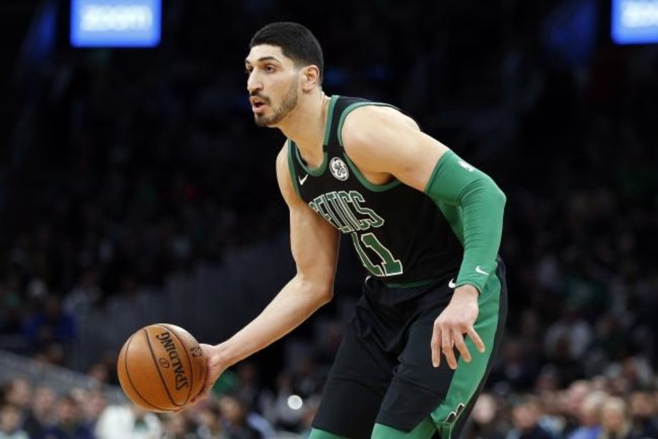 Photo -  Boston Celtics' Enes Kanter plays against the Oklahoma City Thunder during the first half of an NBA basketball game, Sunday, March, 8, 2020, in Boston. (AP Photo/Michael Dwyer)
