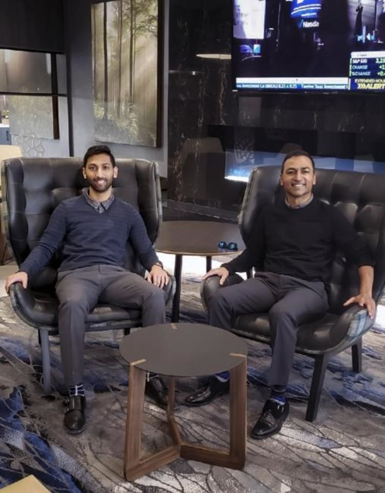 Photo -  Anish and Andy Patel, from left, visit in the lobby of the new Fairfield Inn and Suites at 10 SW 4.  [Provided]