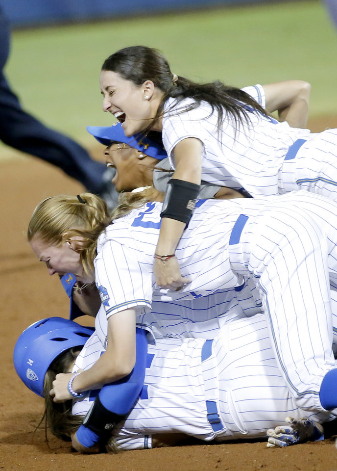 Photo - UCLA celebrates the Women's College World Series championship at USA Softball Hall of Fame Stadium in Oklahoma City, Tuesday, June 4, 2019. [Sarah Phipps/The Oklahoman]