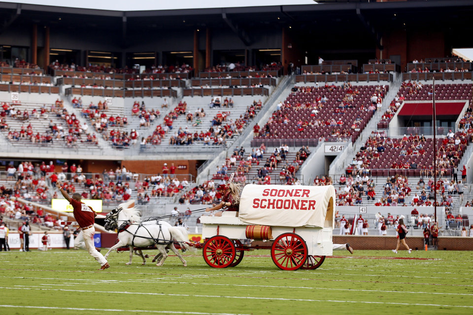 Photo -  The Sooner Schooner runs onto the field after an OU touchdown Saturday during a 48-0 win against Missouri State in Norman. [Ian Maule/Tulsa World via AP]