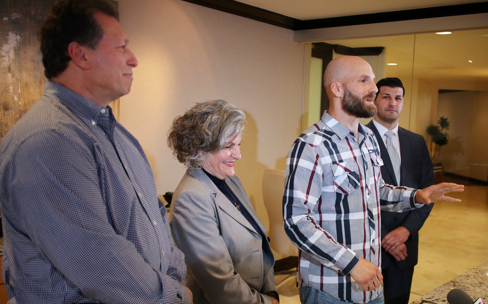 Photo - Scott, Vicki, Michael and Brett Behenna at a family press conference for the Presidential Pardon Michael Behenna received Monday, in downtown Oklahoma City, Wednesday, May 8, 2019.  Photo by Doug Hoke.