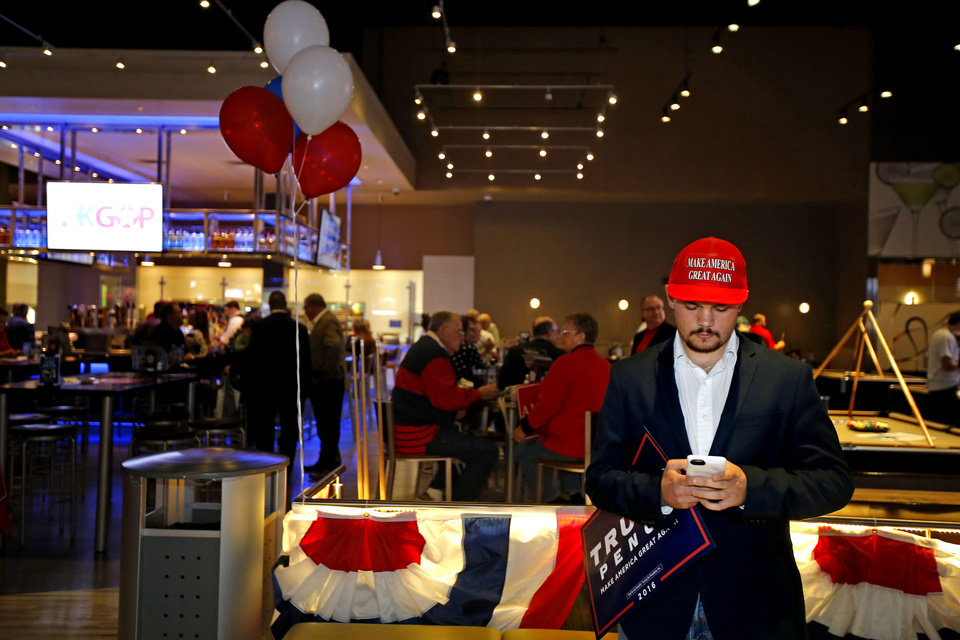Photo - University of Oklahoma student Jackson Bond, from Dallas, waits for his friend to arrive as Republican Party backers gathered Tuesday night at Main Event Entertainment in northwest Oklahoma City as election returns rolled in the presidential race against Donald Trump and Democrat Hillary Clinton. Oklahomans on Tuesday also cast votes on several state ballot measures, a host of legislative contests and other local issues and offices. Photo by Bryan Terry, The Oklahoman