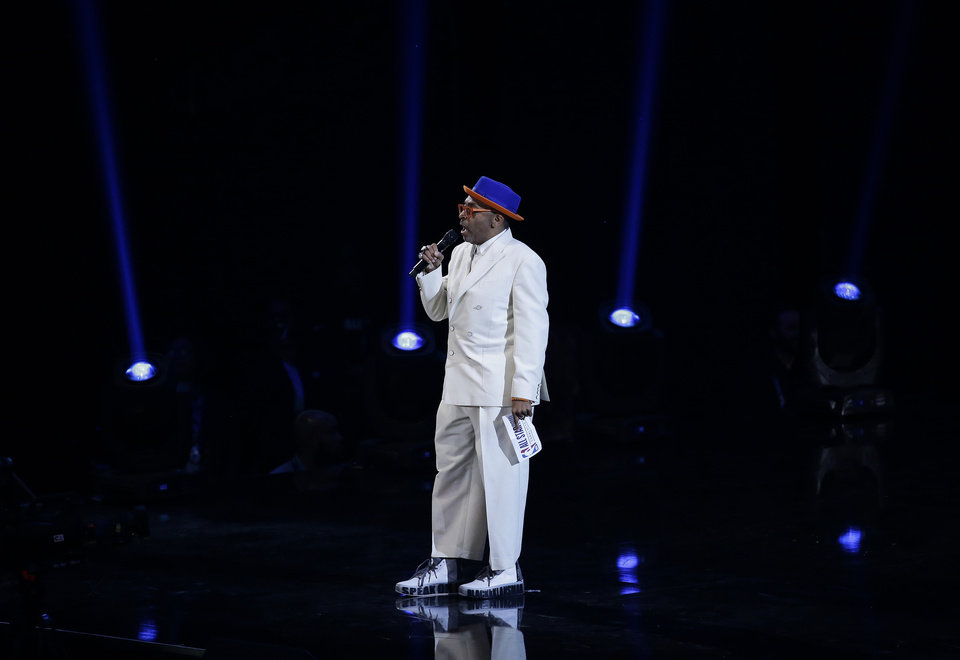 Photo - Director Spike Lee speaks during the first half of an NBA All-Star basketball game, Sunday, Feb. 17, 2019, in Charlotte, N.C. (AP Photo/Gerry Broome)
