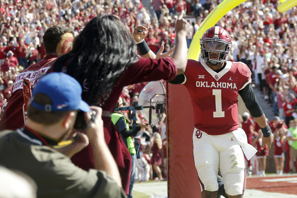 Photo - Oklahoma's Jalen Hurts (1) celebrates after a touchdown during a college football game between the University of Oklahoma Sooners (OU) and the West Virginia Mountaineers at Gaylord Family-Oklahoma Memorial Stadium in Norman, Okla, Saturday, Oct. 19, 2019. Oklahoma won 52-14. [Bryan Terry/The Oklahoman]