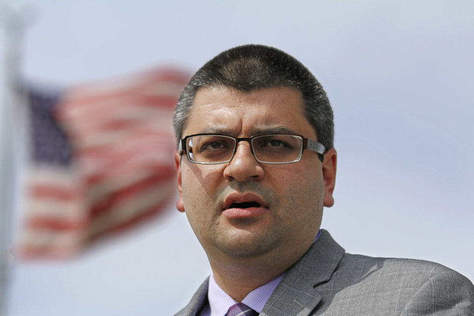 Photo - Adam Soltani, Executive director of Council on American-Islamic Relations speaks during a press conference called by CAIR-OK in front of Republican Headquarters in response to Rep. John Bennett's statements about Muslims Wednesday, Sept. 15, 2014. Photo by Doug Hoke, The Oklahoman