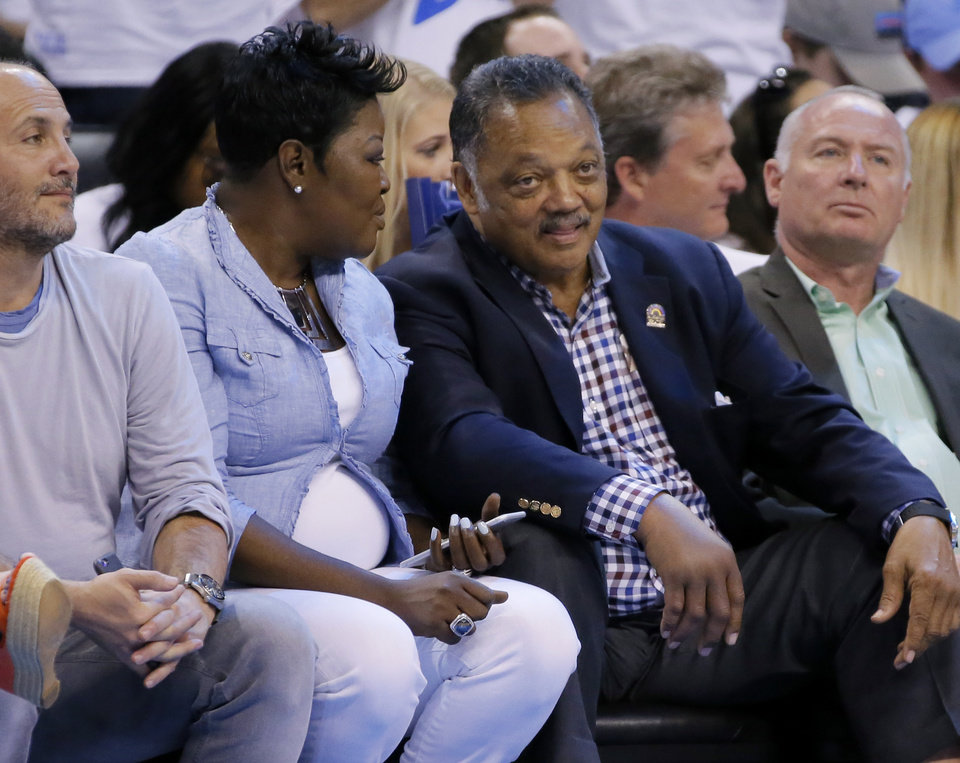Photo - Jesse Jackson talks with Wanda Pratt, Kevin Durant's mother, during Game 3 of the Western Conference finals in the NBA playoffs between the Oklahoma City Thunder and the Golden State Warriors at Chesapeake Energy Arena in Oklahoma City, Sunday, May 22, 2016. Oklahoma City won 133-105. Photo by Bryan Terry, The Oklahoman