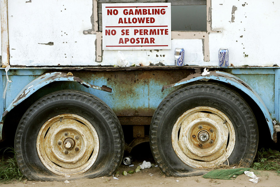 Photo - A sign hangs from a food cart at the track during a raid on a suspected illegal horse racing operation near Thackerville, OK., on Sunday, July 29, 2007. By John Clanton, The Oklahoman