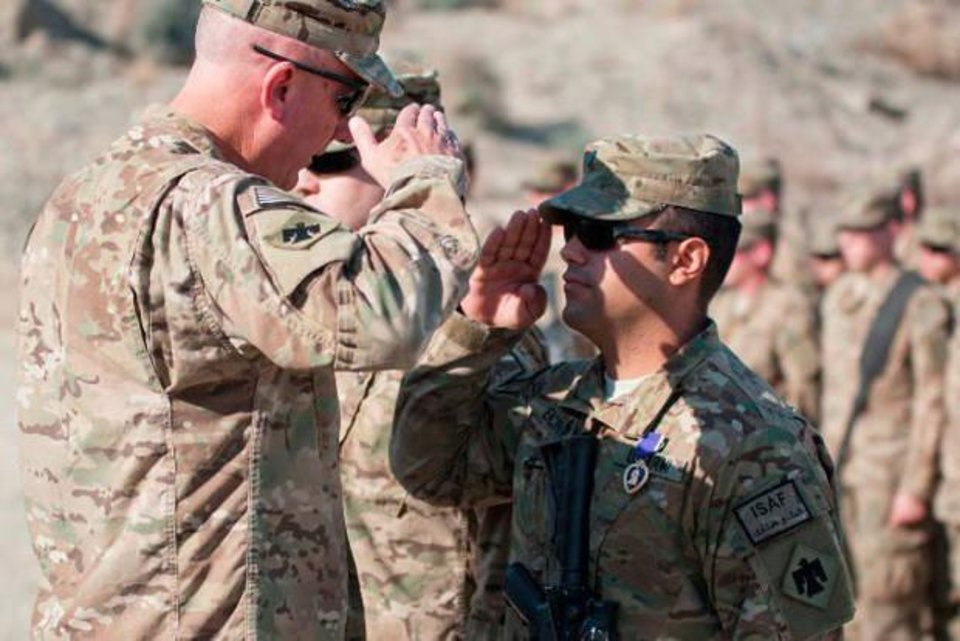 Photo -  Josh Encinas is awarded the Purple Heart picture in Afghanistan at COP Xio Haq. [Photo provided]