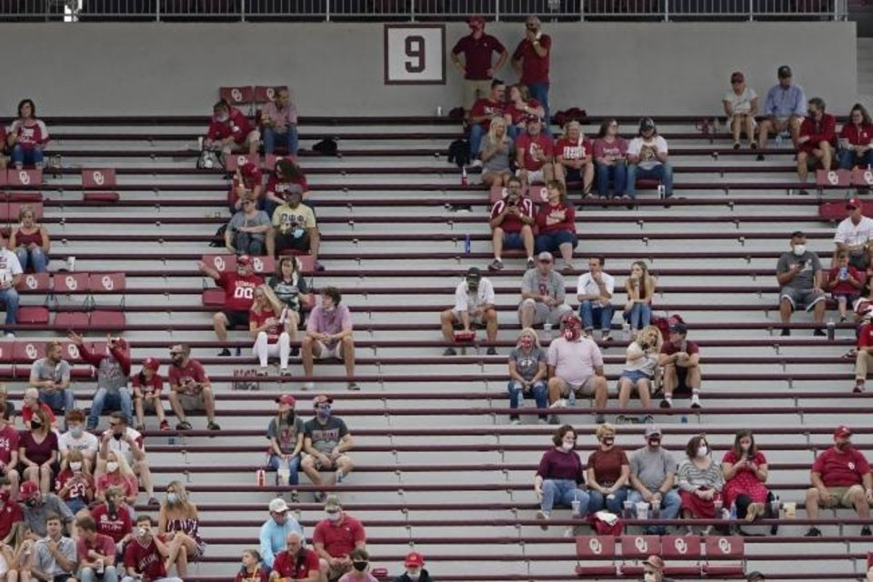 Photo -  Fans socially distance in the stands before OU's 48-0 win against Missouri State on Saturday in Norman. [AP Photo/Sue Ogrocki]