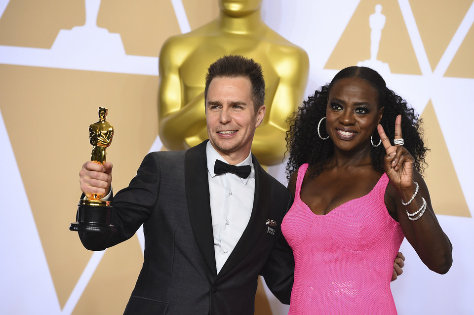 "Photo - Sam Rockwell, winner of the award for best performance by an actor in a supporting role for ""Three Billboards Outside Ebbing, Missouri"", and Viola Davis, right, pose in the press room at the Oscars on Sunday, March 4, 2018, at the Dolby Theatre in Los Angeles. (Photo by Jordan Strauss/Invision/AP)"