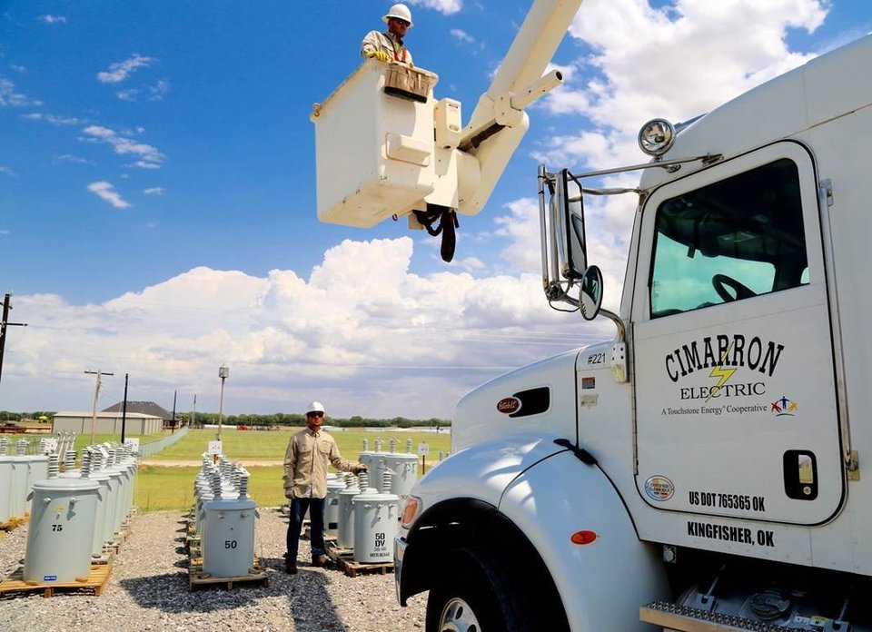 Photo -  Cimarron Electric Cooperative workers prepare to load a needed transformer to serve a new location within a 9,000-square-mile service area that covers parts of nine Oklahoma counties.