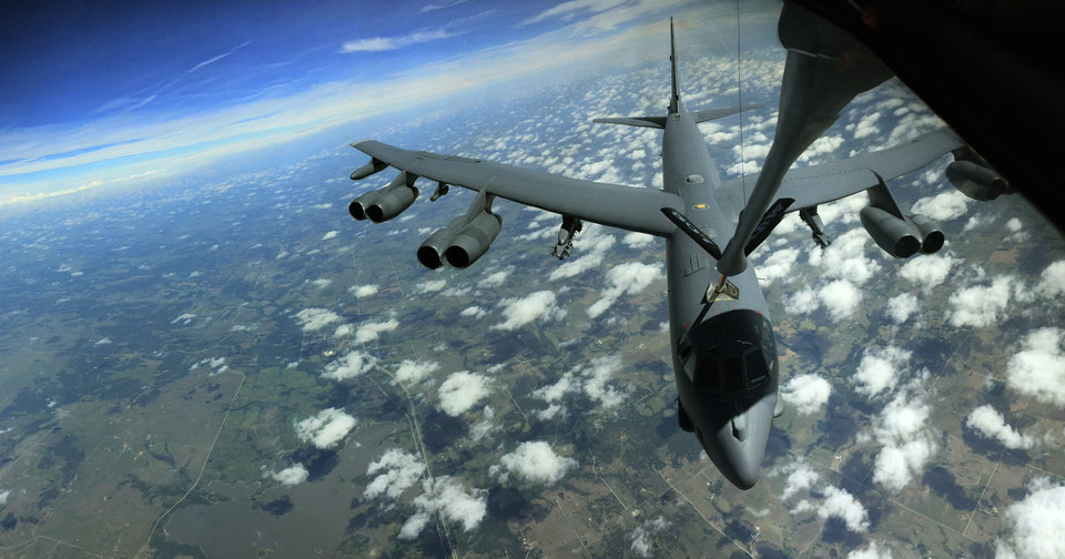 Photo -   Above : A B-52 Stratofortress connects with a refueling boom during a practice rendezvous with a KC-135 Stratotanker. The tanker's crew members are part of the 507th Air Refueling Wing, a U.S. Air Force Reserve unit based at Tinker Air Force Base. [Photo by Paul Hellstern, The Oklahoman]