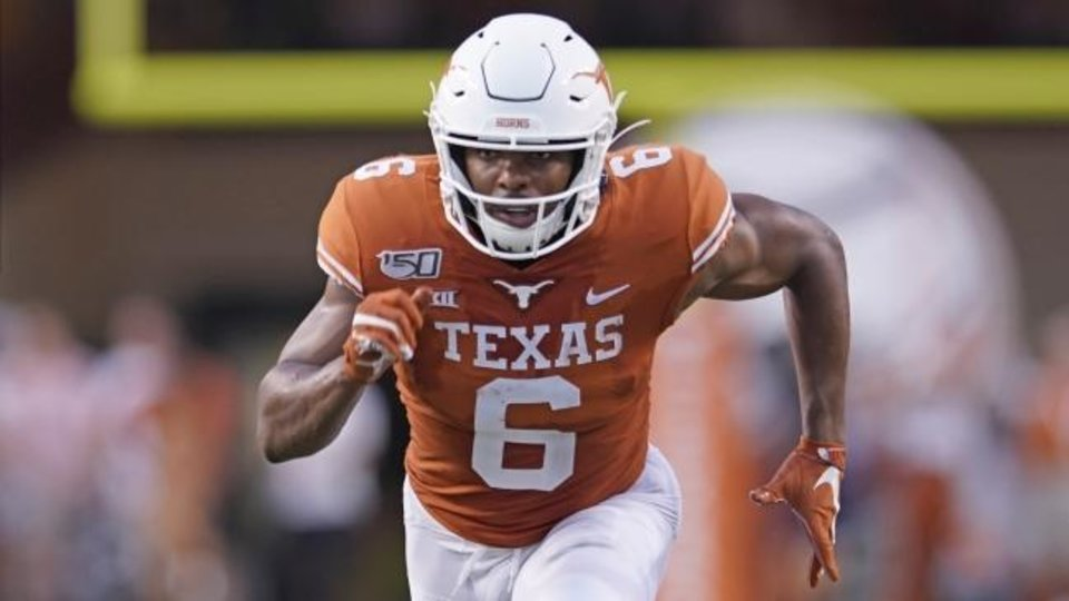 Photo -  Texas receiver Devin Duvernay could be a main target for quarterback Sam Ehlinger on Saturday. [AP Photo/Chuck Burton]