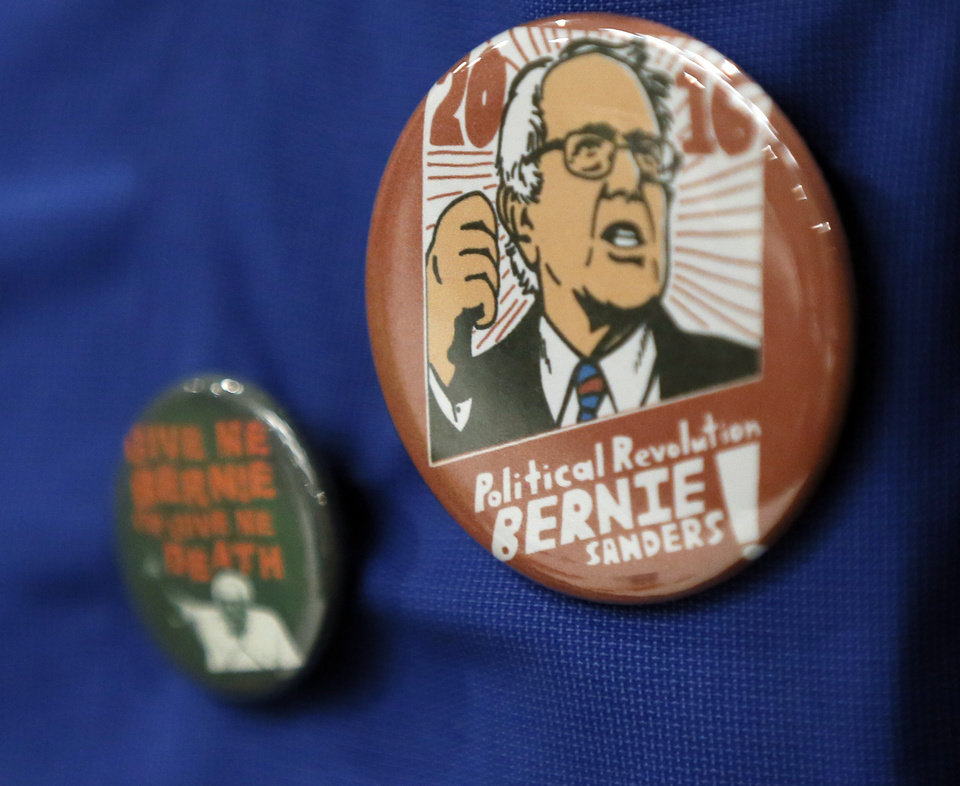Photo - Bernie Sanders buttons on a supporter during a Democratic National Convention watch party for Bernie Sanders supporters at the Holiday Inn Express, 1629 S. Prospect Ave., in Oklahoma City, Monday, July 25, 2016. Photo by Nate Billings, The Oklahoman