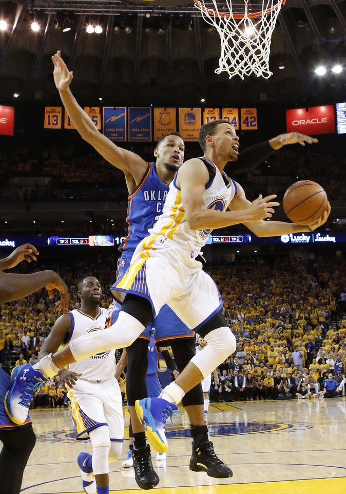 Photo - Golden State's Stephen Curry (30) tries to score past Oklahoma City's Andre Roberson (21) during Game 5 of the Western Conference finals in the NBA playoffs between the Oklahoma City Thunder and the Golden State Warriors at Oracle Arena in Oakland, Calif., Thursday, May 26, 2016. The Warriors won 120-111. Photo by Nate Billings, The Oklahoman