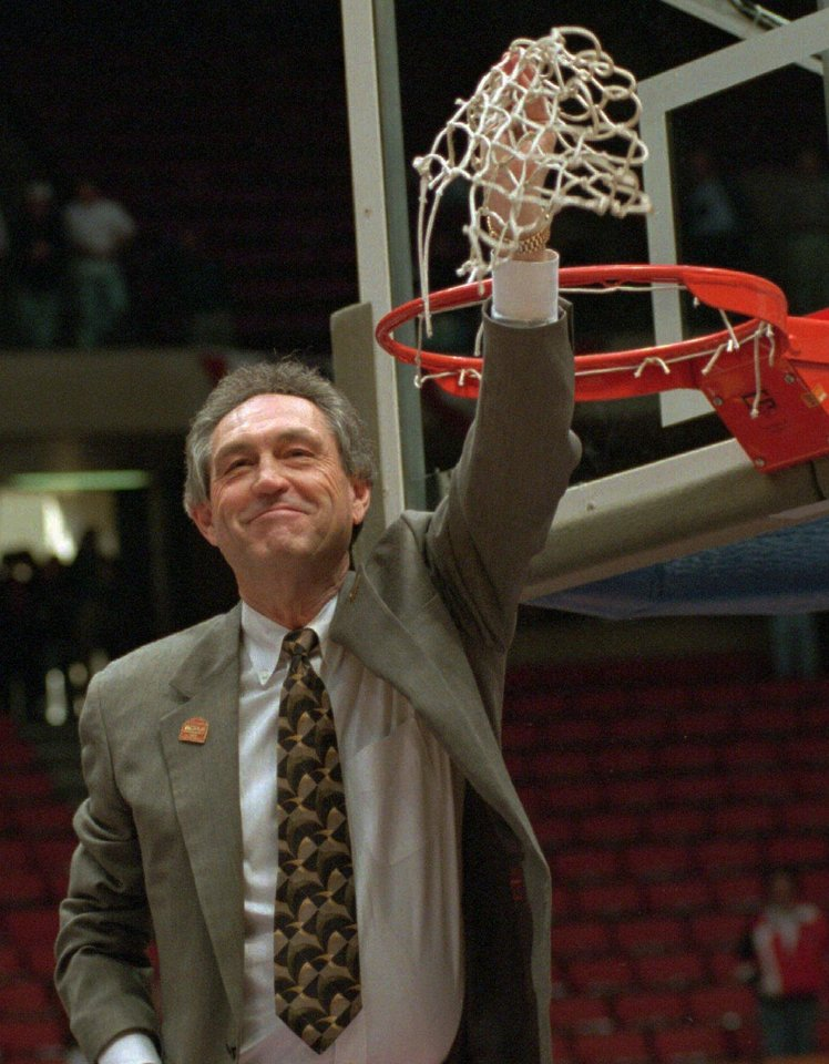 Photo - OSU basketball coach Eddie Sutton holds up the net in celebration after his team defeated Massachusetts 68-54 in the East Regional NCAA championship Sunday afternoon, March 26, 1995, at the Meadowlands Arena in East Rutherford, N.J.  (AP Photo/Bill Kostroun)