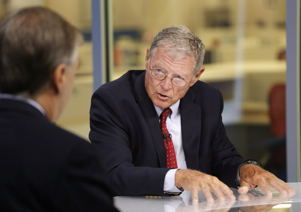 Photo - Sen. Jim Inhofe discusses the Senate's highway bill Tuesday, August 25, 2015 with the Oklahoman's Rick Green. Photo by Doug Hoke, The Oklahoman