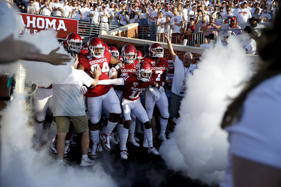 Photo - Oklahoma takes the field before a college football game between the University of Oklahoma Sooners (OU) and the Houston Cougars at Gaylord Family-Oklahoma Memorial Stadium in Norman, Okla., Sunday, Sept. 1, 2019. Oklahoma won 49-31. [Bryan Terry/The Oklahoman]