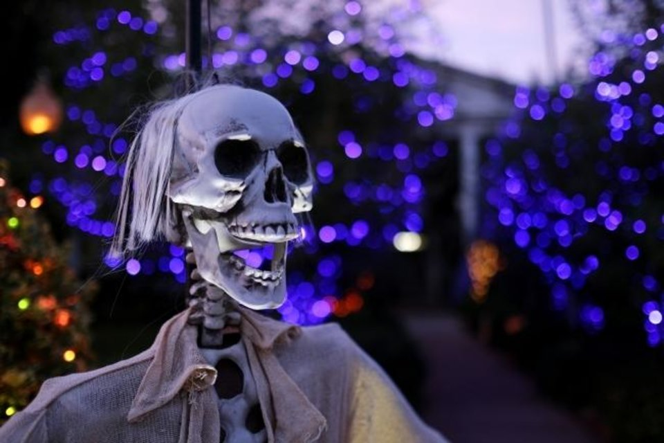Photo -  Some people opted out of Halloween 2020 because of the coronavirus, or found creative ways to treat trick-or-treaters while maintaining social distancing. Spooky yard decorations seemed more prevalent, like this scary skull at 729 NW 38. [DOUG HOKE/THE OKLAHOMAN ARCHIVES]