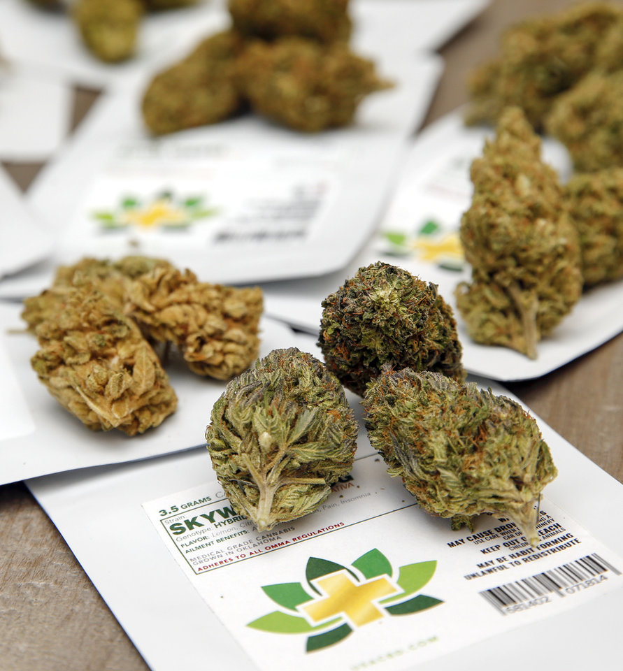 Photo -  Cannabis flowers along with their packaging are shown at CBD Plus USA on Monday in Oklahoma City. [Photo by Nate Billings, The Oklahoman]