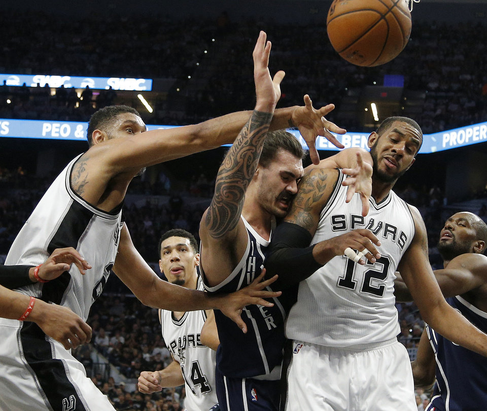 Photo - Oklahoma City's Steven Adams (12) loses the ball between San Antonio's Tim Duncan (21) and LaMarcus Aldridge (12) during Game 1 of the second-round series between the Oklahoma City Thunder and the San Antonio Spurs in the NBA playoffs at the AT&T Center in San Antonio, Saturday, April 30, 2016. Photo by Bryan Terry, The Oklahoman