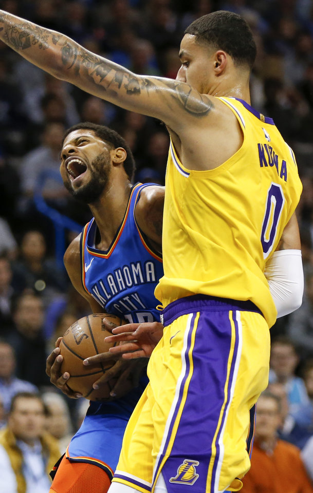 Photo - Oklahoma City's Paul George (13) tries to score against Los Angeles' Kyle Kuzma (0) during an NBA basketball game between the Los Angeles Lakers and the Oklahoma City Thunder at Chesapeake Energy Arena in Oklahoma City, Thursday, Jan. 17, 2019. Photo by Nate Billings, The Oklahoman
