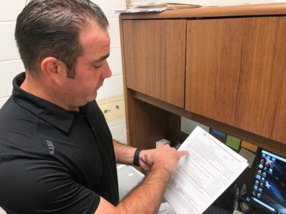Photo -  Michael Walden, special victims detective with the Idabel Police Department, said he personally responds to most domestic-violence calls to help make sure sufficient evidence is collected. [Whitney Bryen/Oklahoma Watch]