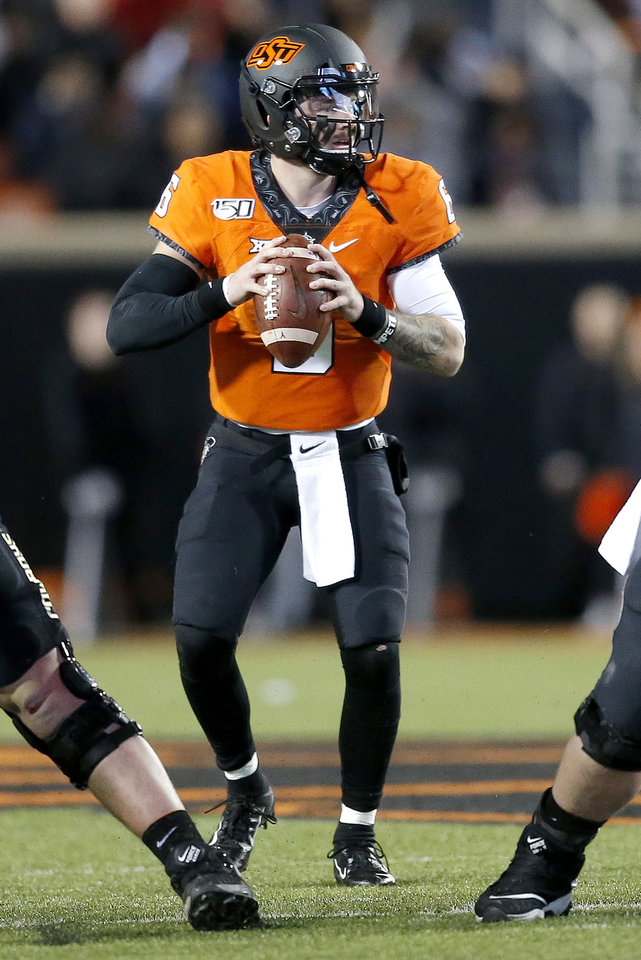 Photo - Oklahoma State's Dru Brown (6) looks to throw the ball in the first quarter during the Bedlam college football game between the Oklahoma State Cowboys (OSU) and Oklahoma Sooners (OU) at Boone Pickens Stadium in Stillwater, Okla., Saturday, Nov. 30, 2019. OU won  34-16. [Sarah Phipps/The Oklahoman]