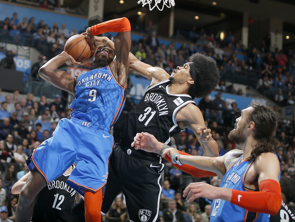 Photo - Oklahoma City's Jerami Grant (9) tries to get a shot up beside Brooklyn's Jarrett Allen (31) during an NBA basketball game between the Oklahoma City Thunder and the Brooklyn Nets at Chesapeake Energy Arena in Oklahoma City, Wednesday, March 13, 2019. Oklahoma City won 108-96. Photo by Bryan Terry, The Oklahoman