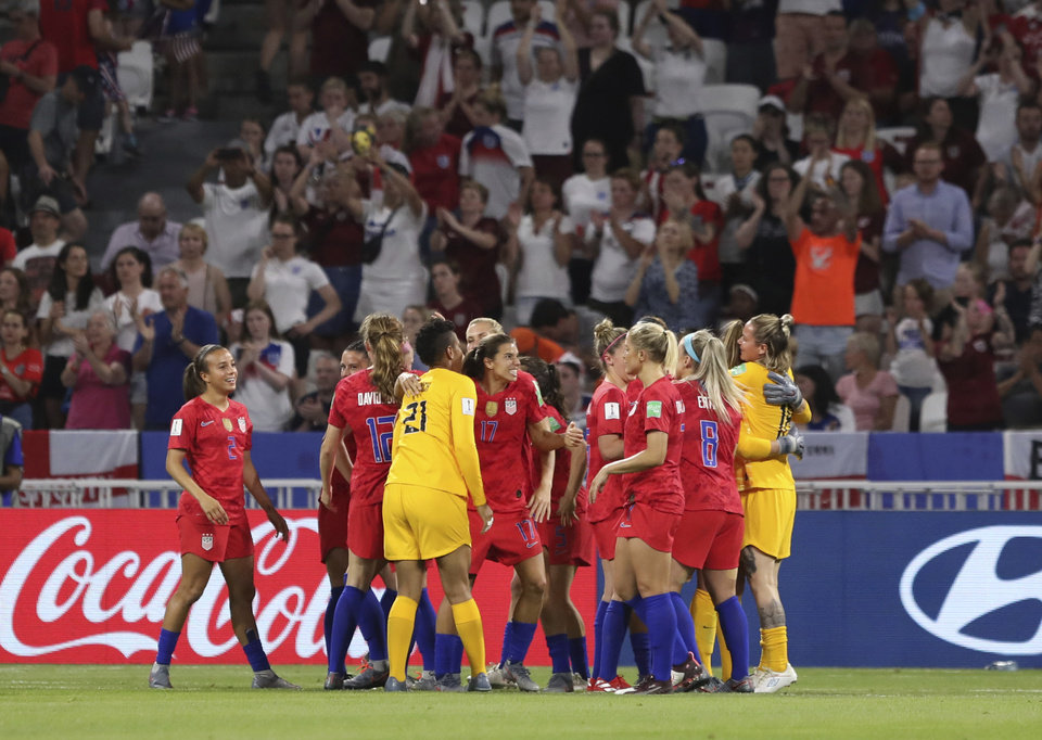 Photo - US players celebrate after the Women's World Cup semifinal soccer match between England and the United States, at the Stade de Lyon outside Lyon, France, Tuesday, July 2, 2019. US won 2-1. (AP Photo/Laurent Cipriani)