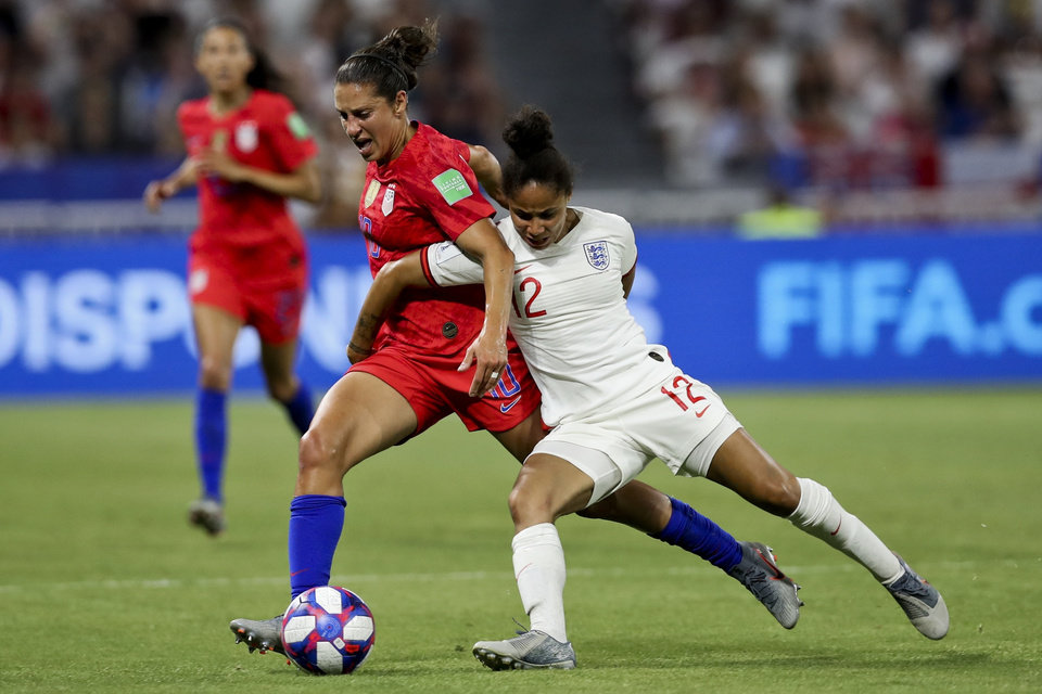 Photo - England's Demi Stokes, right, and United States' Carli Lloyd duel for the ball during the Women's World Cup semifinal soccer match between England and the United States, at the Stade de Lyon outside Lyon, France, Tuesday, July 2, 2019. (AP Photo/Francisco Seco)