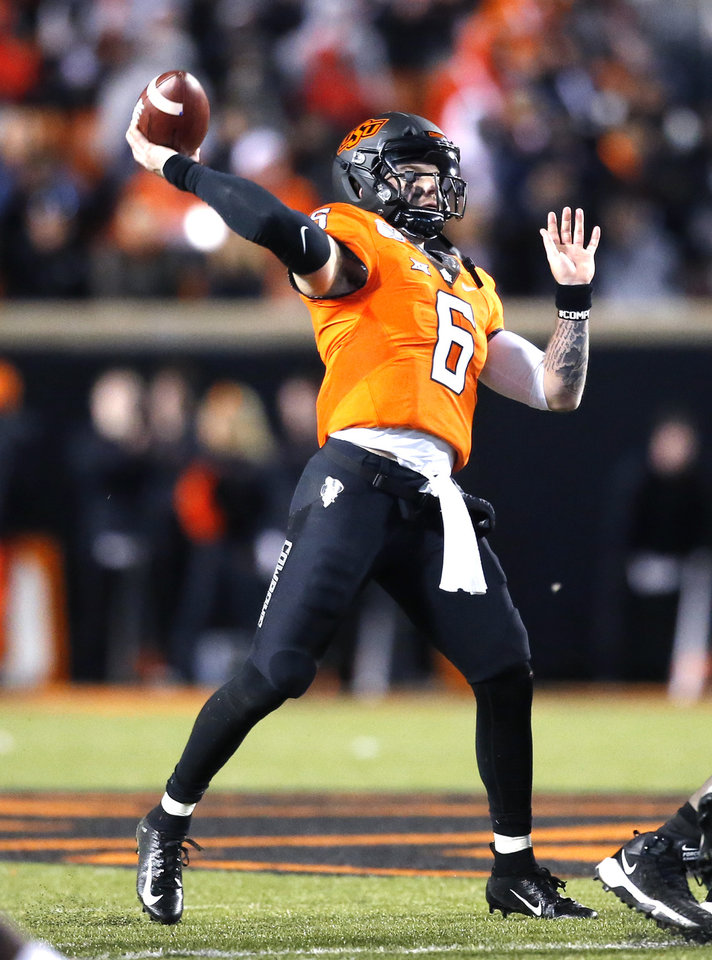 Photo - Oklahoma State's Dru Brown (6) throws a pass in the third quarter during the Bedlam college football game between the Oklahoma State Cowboys (OSU) and Oklahoma Sooners (OU) at Boone Pickens Stadium in Stillwater, Okla., Saturday, Nov. 30, 2019. OU won  34-16. [Sarah Phipps/The Oklahoman]
