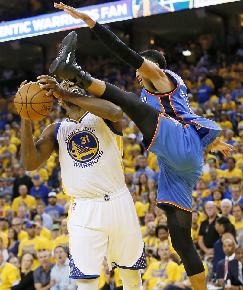 Photo - Oklahoma City's Andre Roberson (21) fouls Golden State's Festus Ezeli (31) during Game 5 of the Western Conference finals in the NBA playoffs between the Oklahoma City Thunder and the Golden State Warriors at Oracle Arena in Oakland, Calif., Thursday, May 26, 2016. The Warriors won 120-111. Photo by Nate Billings, The Oklahoman