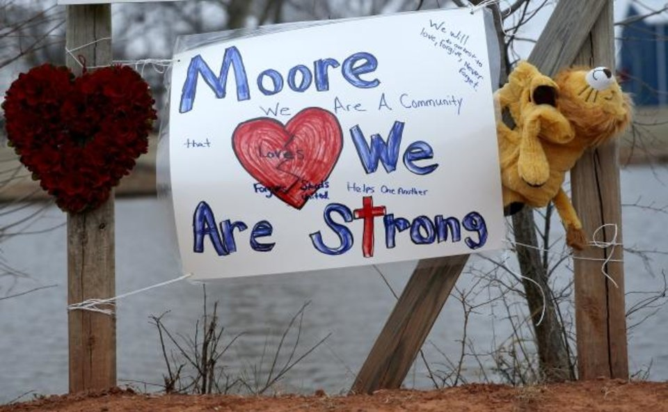 Photo -  Memorials and posters have been placed at the site of Monday's crash in Moore. [Sarah Phipps/The Oklahoman]