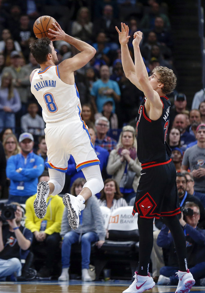 Photo - Oklahoma City's Danilo Gallinari (8) shoots as Chicago's Lauri Markkanen (24) defends in the fourth quarter during an NBA basketball game between the Oklahoma City Thunder and Chicago Bulls at Chesapeake Energy Arena in Oklahoma City, Monday, Dec. 16, 2019. Oklahoma City won 109-106. [Nate Billings/The Oklahoman]