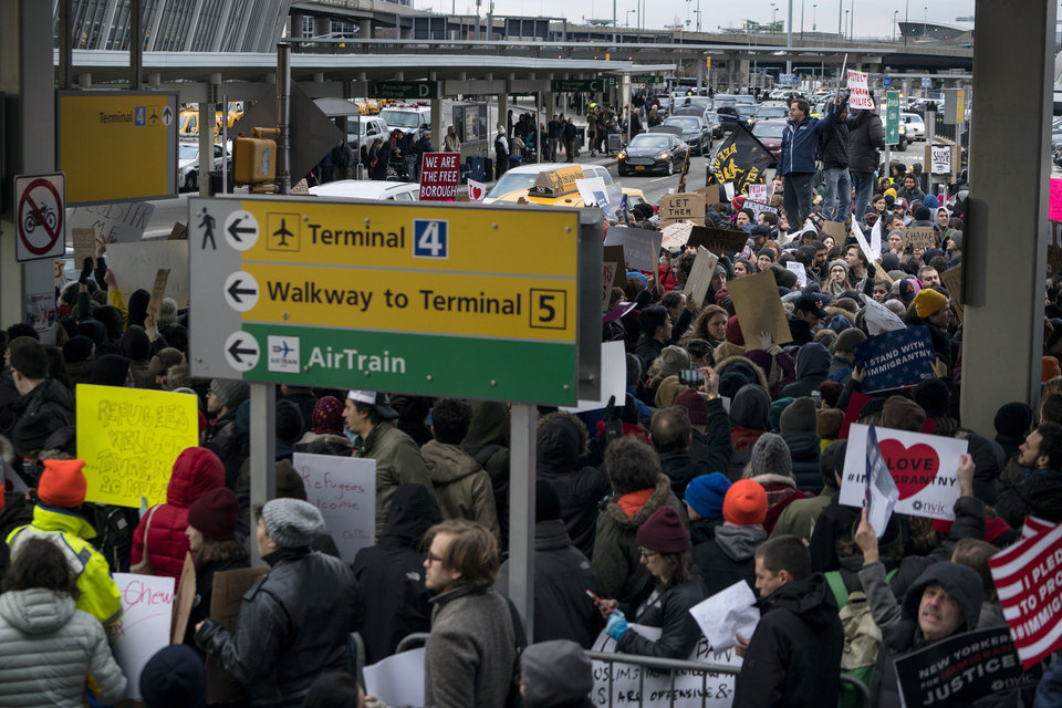 Photo - Protesters assemble at John F. Kennedy International Airport in New York, Saturday, Jan. 28, 2017 after two Iraqi refugees were detained while trying to enter the country. On Friday, Jan. 27, President Donald Trump signed an executive order suspending all immigration from countries with terrorism concerns for 90 days. Countries included in the ban are Iraq, Syria, Iran, Sudan, Libya, Somalia and Yemen, which are all Muslim-majority nations. (AP Photo/Craig Ruttle)
