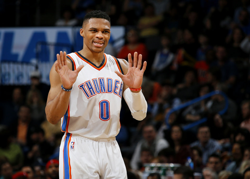 Photo - Oklahoma City's Russell Westbrook (0) gestures during an NBA basketball game between the Oklahoma City Thunder and the Houston Rockets at Chesapeake Energy Arena in Oklahoma City, Friday, Jan. 29, 2016. Oklahoma City won 116-108. Photo by Bryan Terry, The Oklahoman