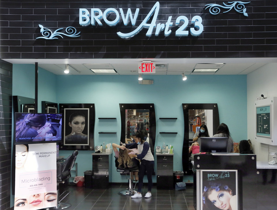 Photo - Brow Art 23 is one of the businesses open at Penn Square Mall during the re-opening of the mall after being closed because of the coronavirus pandemic, in Oklahoma City, Friday, May 1, 2020. [Nate Billings/The Oklahoman]