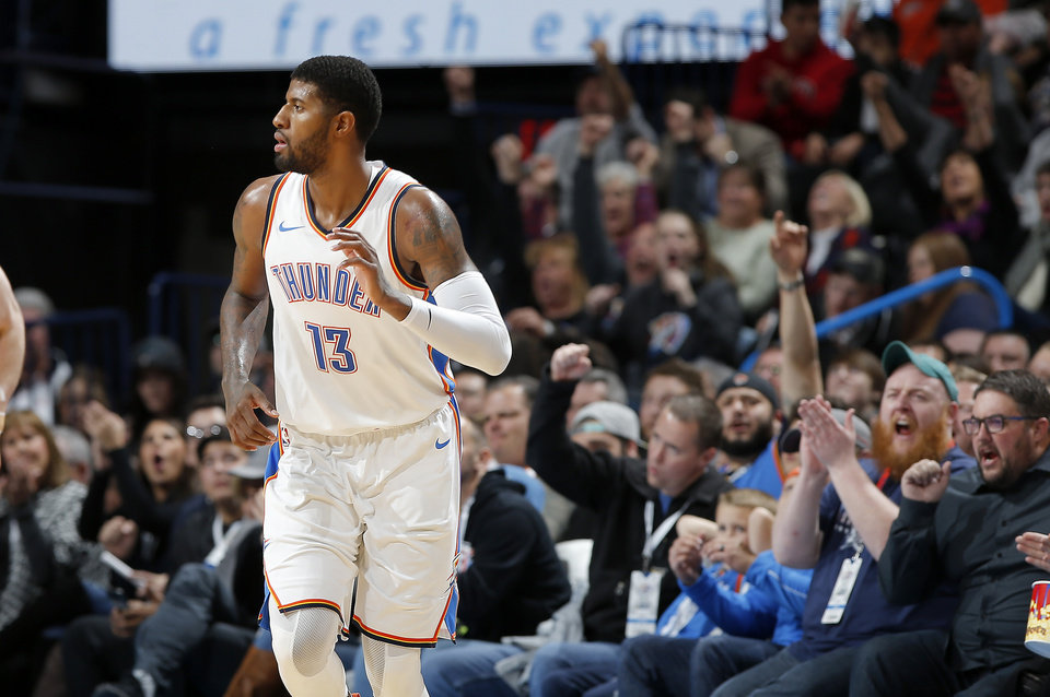 Photo - The Oklahoma City crowd cheers for Paul George during a game between the Thunder and the Utah Jazz. George capped off a three-part ESPN series about his offseason by saying he's