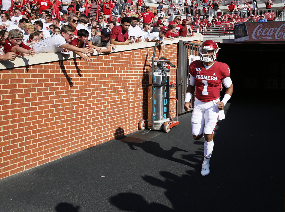 Photo - Oklahoma's Jalen Hurts (1) takes the field to warm up before a college football game between the Oklahoma Sooners (OU) and South Dakota Coyotes at Gaylord Family - Oklahoma Memorial Stadium in Norman, Okla., Saturday, Sept. 7, 2019. [Nate Billings/The Oklahoman]