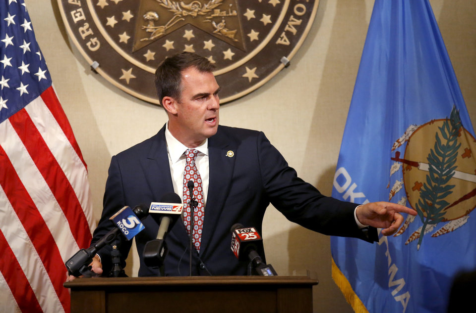 Photo - Gov. Kevin Stitt gives an update to Covid-19 at the Oklahoma state Capitol in Oklahoma City, Thursday, July 9, 2020. Photo by Sarah Phipps, The Oklahoman